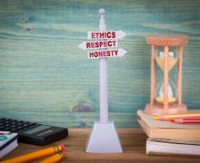 Ethics respect honesty, code of conduct. Signpost on wooden table