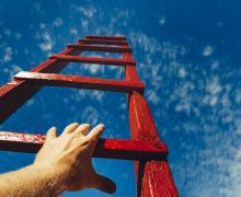reaching for a rung on a ladder