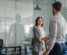 Manager welcoming woman in office