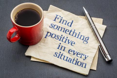 Coffee cup and positivity message